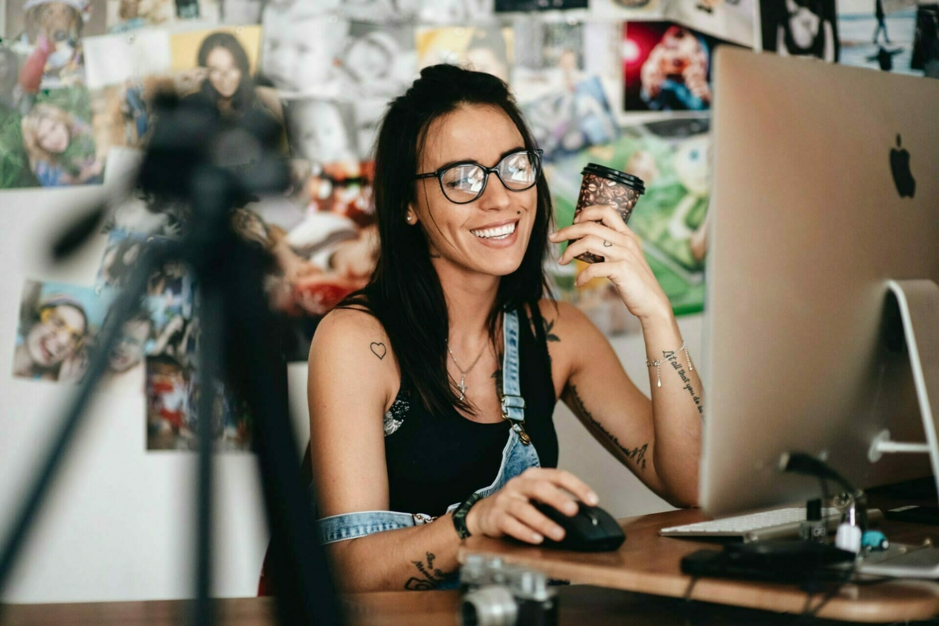 Business Owner Smiling At Positive Comments About Her Business On Social Media