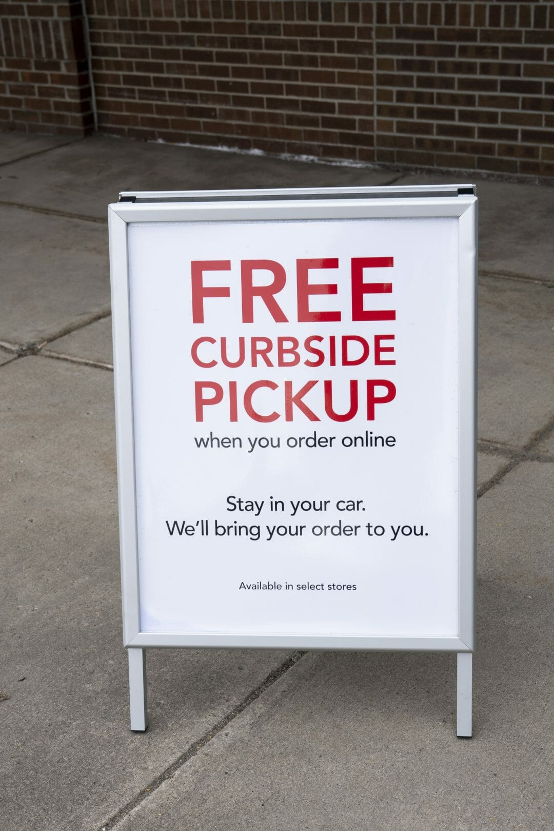 A Sign Reads Free Curbside Pickup Outside Retail Store